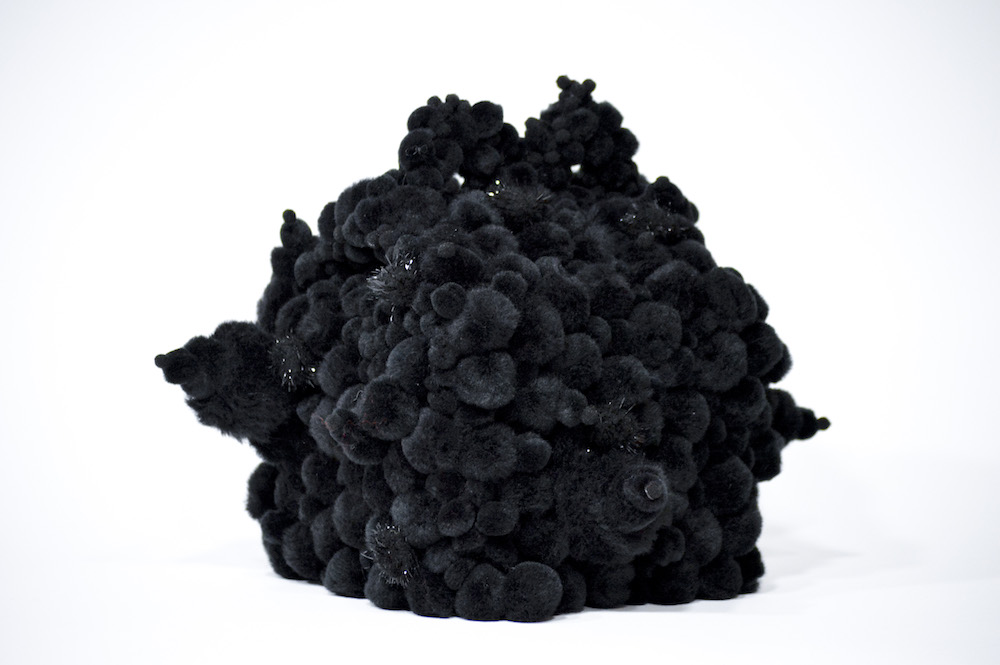pom poms on found object